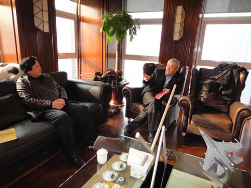 本院院长李伟林与泛华集团党委书记、董事长、总裁杨天举洽谈
